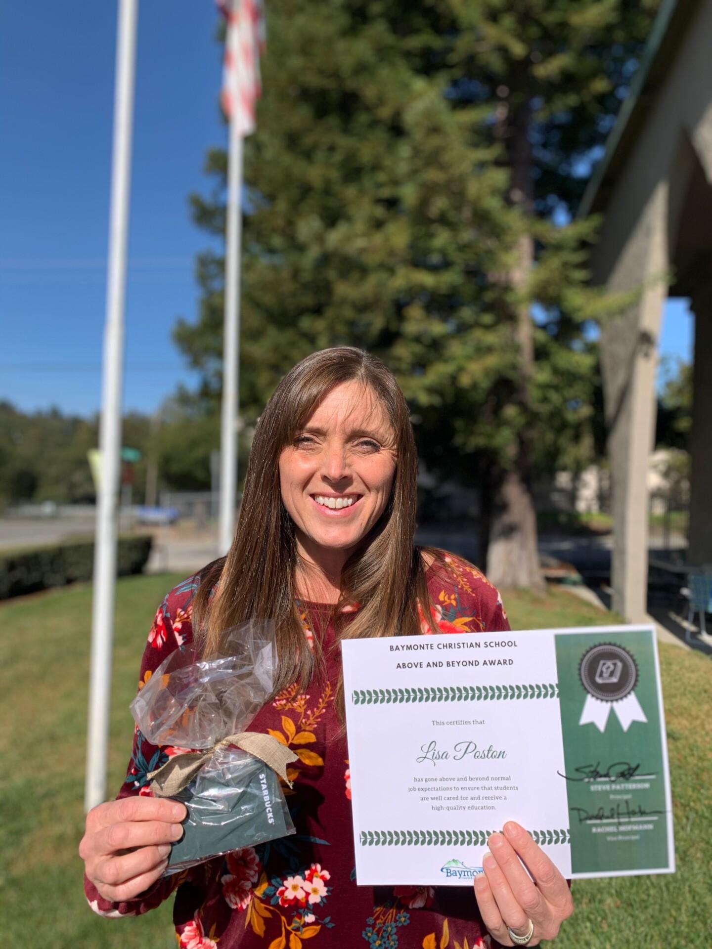 Above and Beyond Award: Lisa Poston