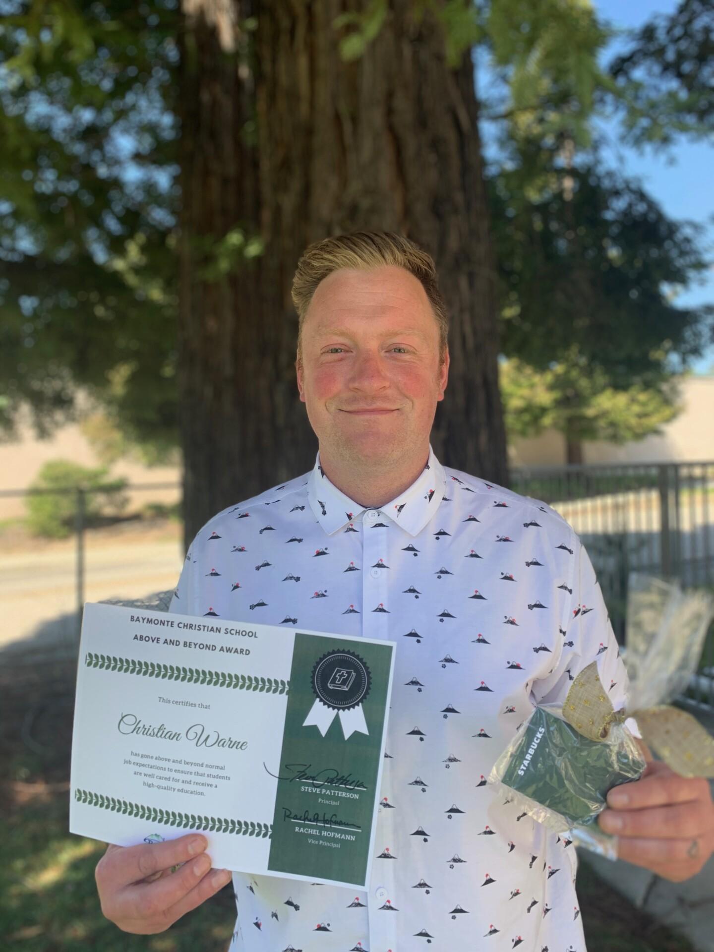 Above and Beyond Award: Christian Warne